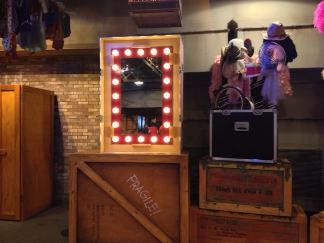 This mirror has been installed for Disney's Story Maker. It sits on a crate that says Fragile! Ship to: Walter Whistler-in residence; The Muppet Theater, USA. It's a reference to Walter, the newest muppet from the recent movie.