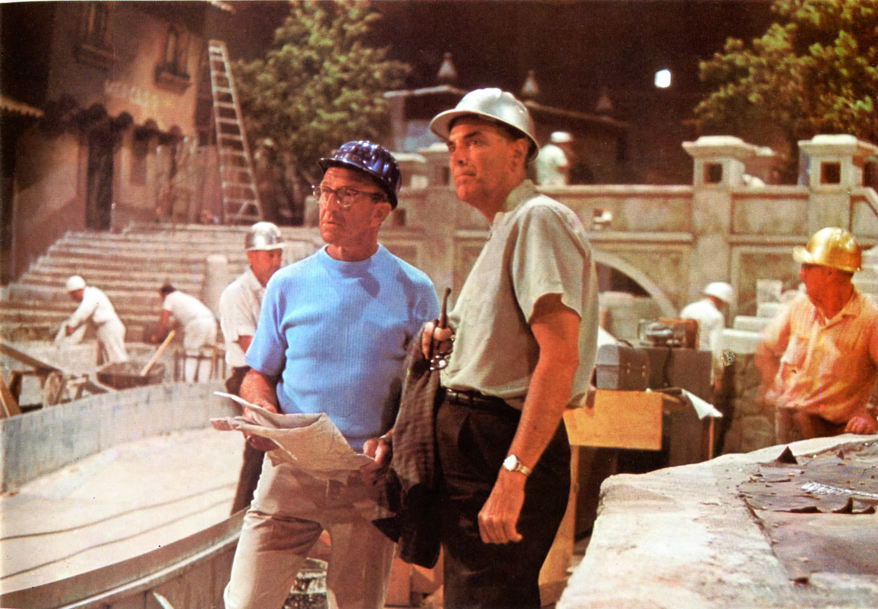 Claude on the right directing the work on Pirates of the Caribbean at Disneyland with Fred Joerger on the left. In the podcast, Tony discovers this picture as an Imagineer and makes an important connection to his relationship with Claude. Copyright Disney.