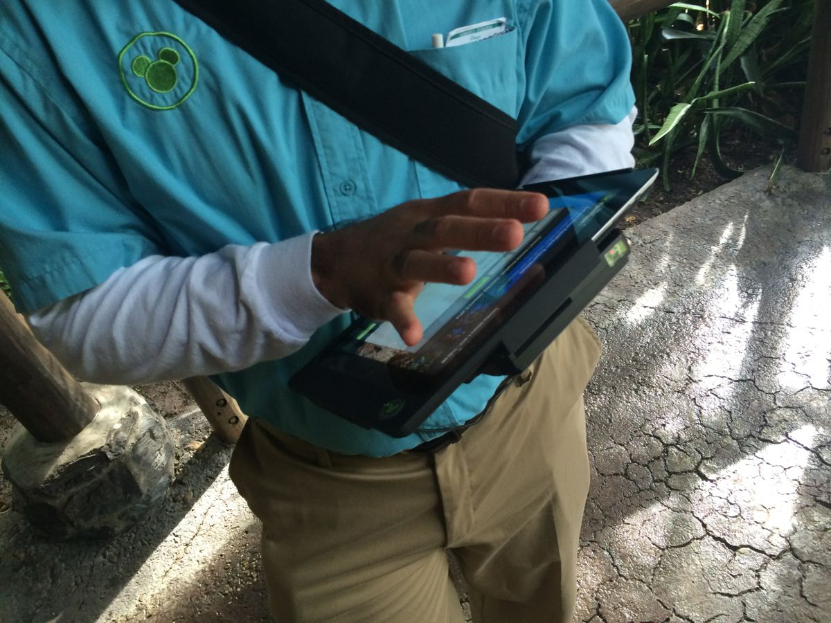 A Disney Cast Member helping non-resort guests with their FastPass+ choices. Photo by J. Jeff Kober