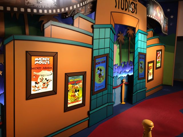 This Mickey Mouse Meet 'n' Greet at the Studios has been there for some time. But look more closely at the movie posters on the wall. They've been changed out completely and are actually monitors set to display different photos when the system is activated. Photo by J. Jeff Kober.