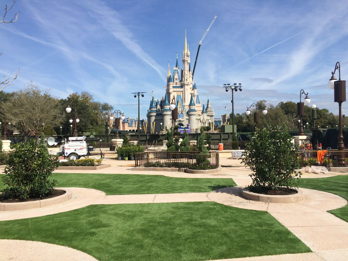 These areas, created with an artificial turf, allow people in the bottleneck to have more space. In fact, their dedicated to guests who want a FastPass+ reservation to see the fireworks. Photo by J. Jeff Kober.