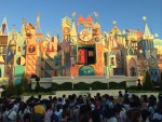 """it's a small world"" where ""One Golden Sun"" smiles as the sun sets in the land of the rising sun."