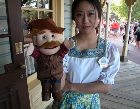 A visa worker from China greeting Guests--not at China in Epcot--but in front of a restaurant in Frontierland at Walt Disney World. The photo was taken when unemployment was over 9% just outside the gates of Walt Disney World. Photo by J. Jeff Kober.