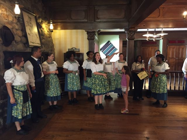 Here Cast Members gather together to celebrate the Ranger of the Day at Pecos Bill's Cafe  Photo by J. Jeff Kober.