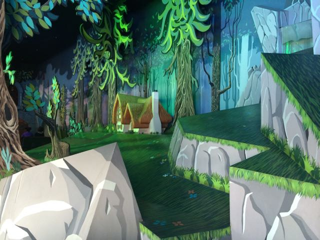 The loading area to Snow White's Scary Adventures at Disneyland Paris. It has a sort of Sleeping Beauty Eyvind Earle look to it. Photo by J. Jeff Kober.