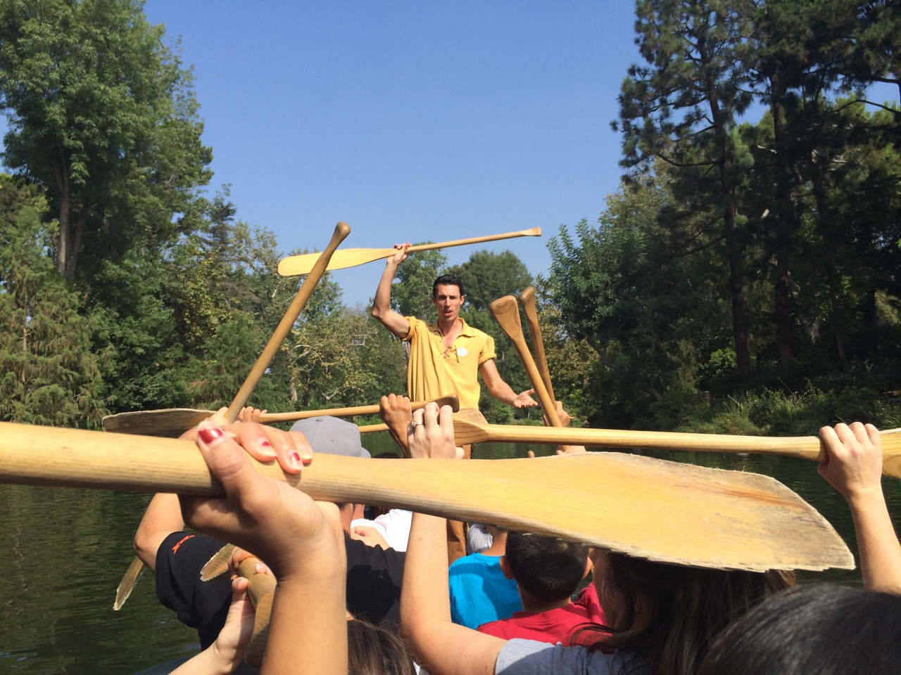 A cast member leads the instruction for canoeing around the Rivers of America at Disneyland. Photo by J. Jeff Kober.