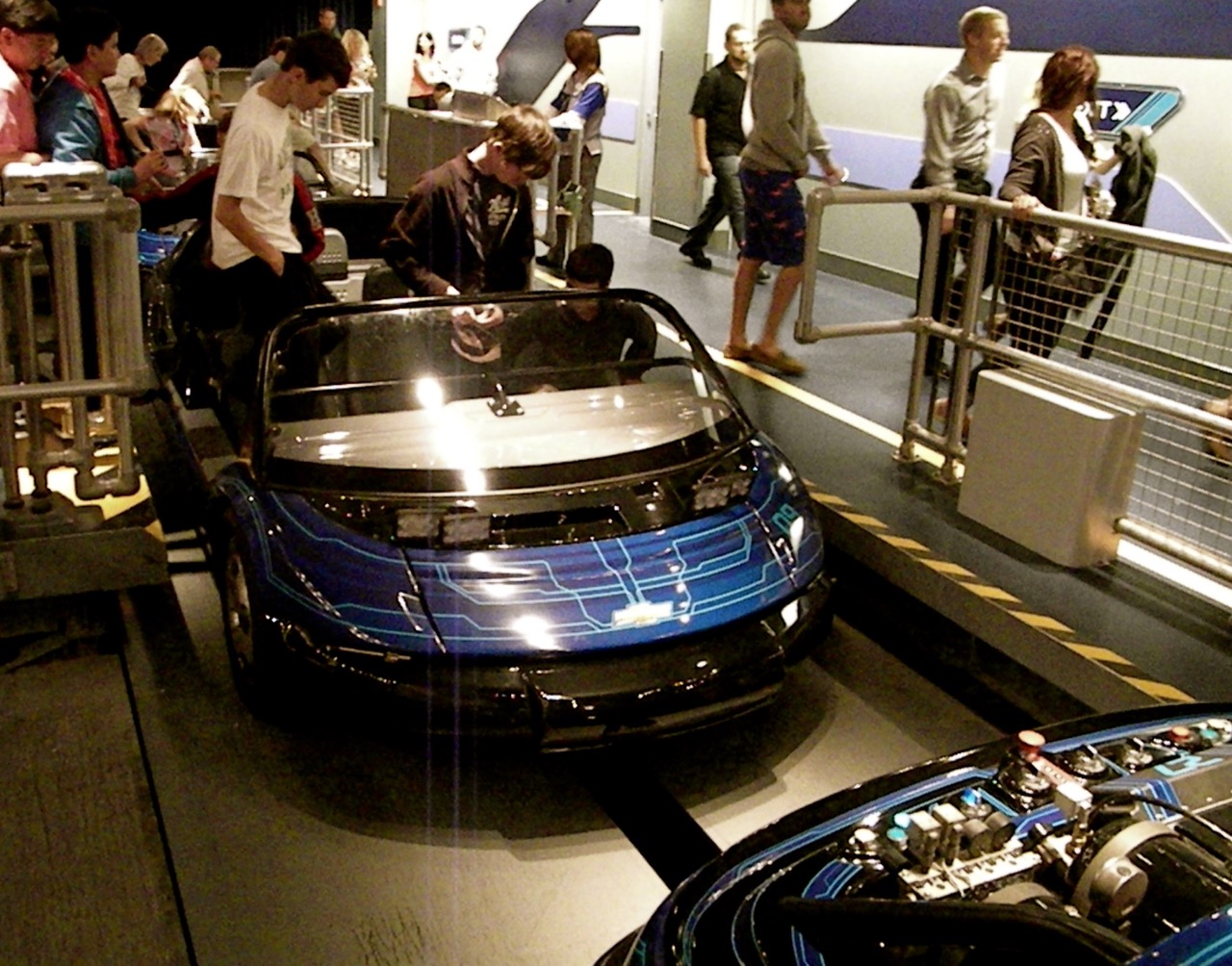 Guests boarding vehicles at Test Track, a complicated attraction where computers manage the acceleration and braking for the passenger. Photo by J. Jeff Kober