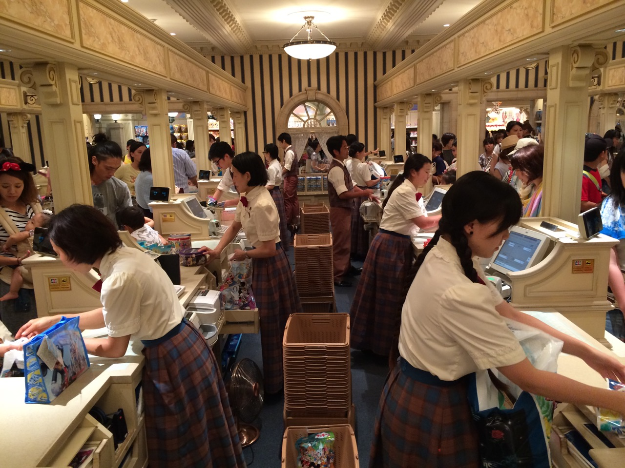 The same checkout concept in Tokyo Disneyland, also with a banking-style theme. Photo by J. Jeff Kober.