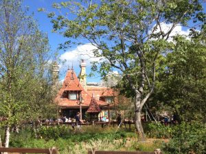 Belle's cottage home is nestled among a glen of trees and shrubs.
